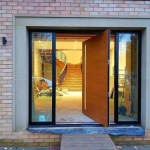 RK Pivot Door - Bespoke design - Open - Golden Oak & RAL 9005