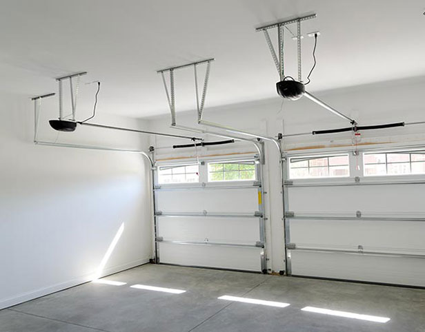 Twin elecric garage door openers