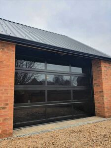 Fortis Glazed Sectional - Jet Black, RAL 9005 with tinted glazing